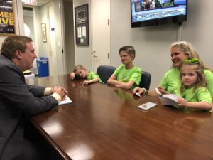 Walker family meets with a Louisiana legislator.