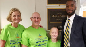 Mary Fete, Virginia Higgins and son meet with an aide from Senator Claire McCaskill's office.