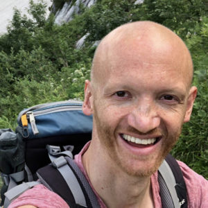 Markus Kappen with backpack on his back hiking.