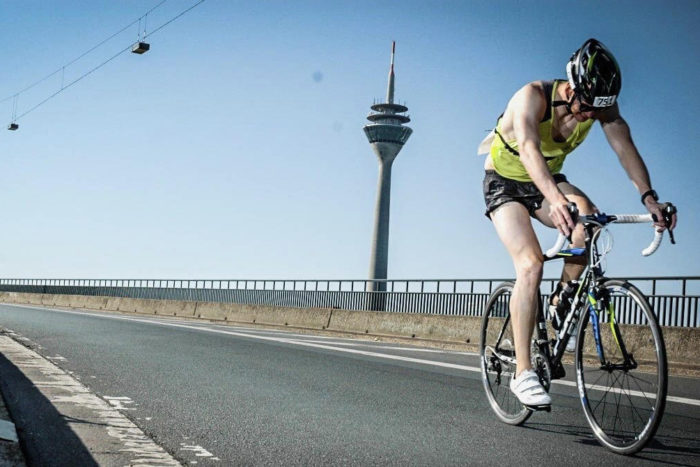 Markus Kappen sits on his bike and looks down at the road during a race.